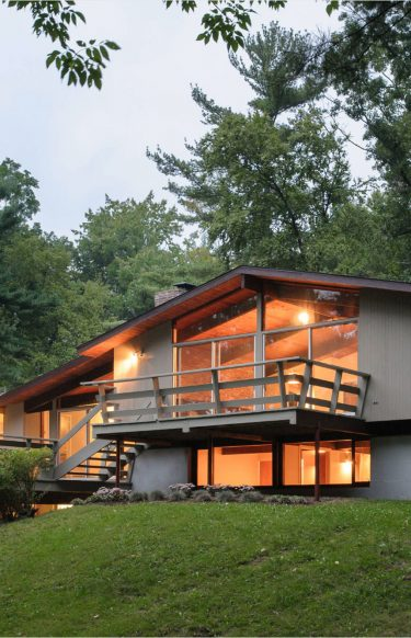 mid-century modern exterior glowing at dusk