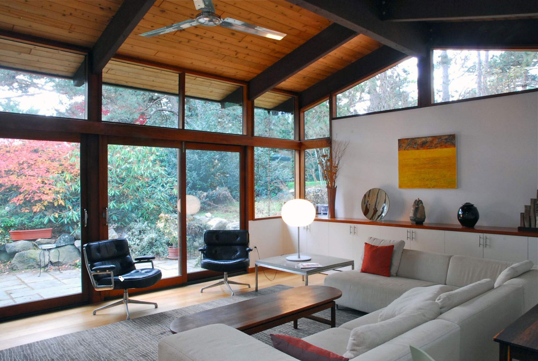 mid-century modern furnished interior large windows