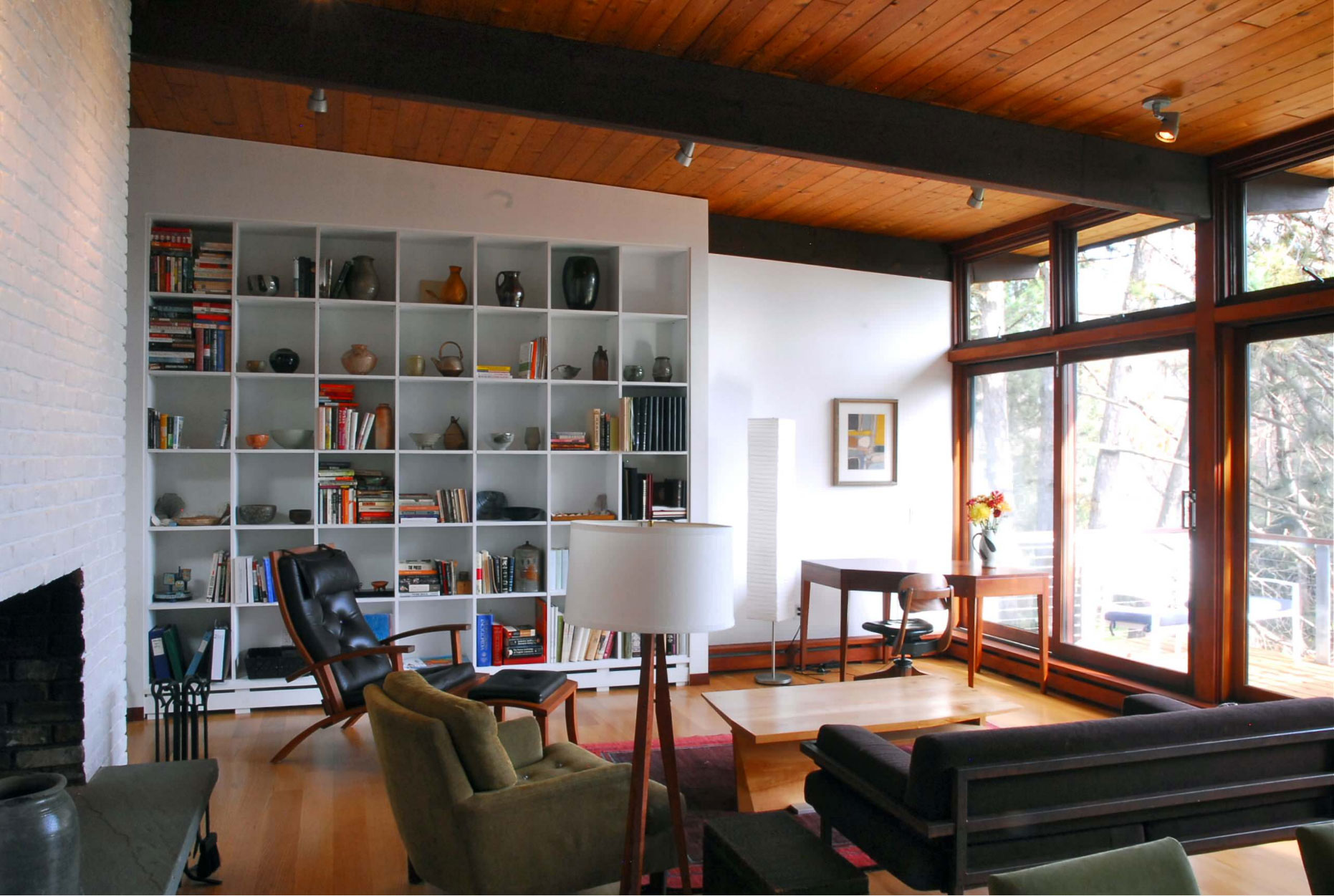 mid-century modern furnished interior built-in bookcase