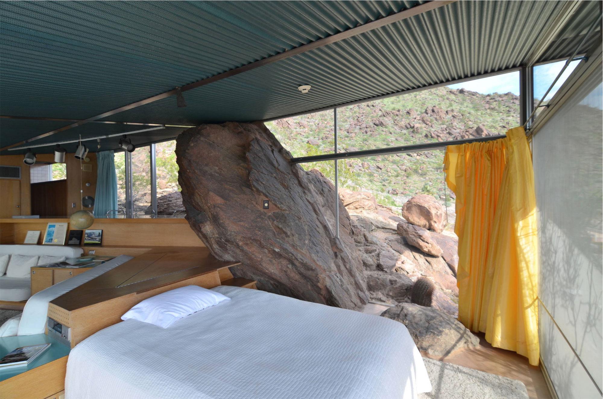 home interior built around boulder coming inside