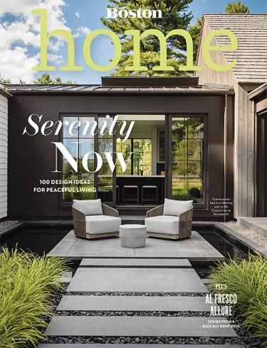 boston home magazine cover with outdoor landscape pavers leading to sitting area