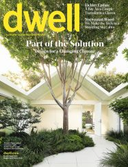 dwell cover with treed courtyard and gable roofed home