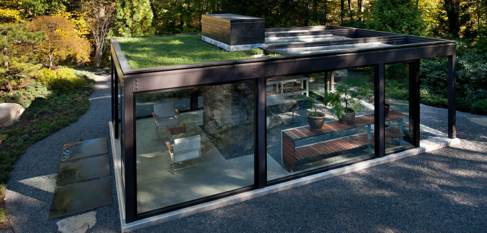glass steel house with live garden roof