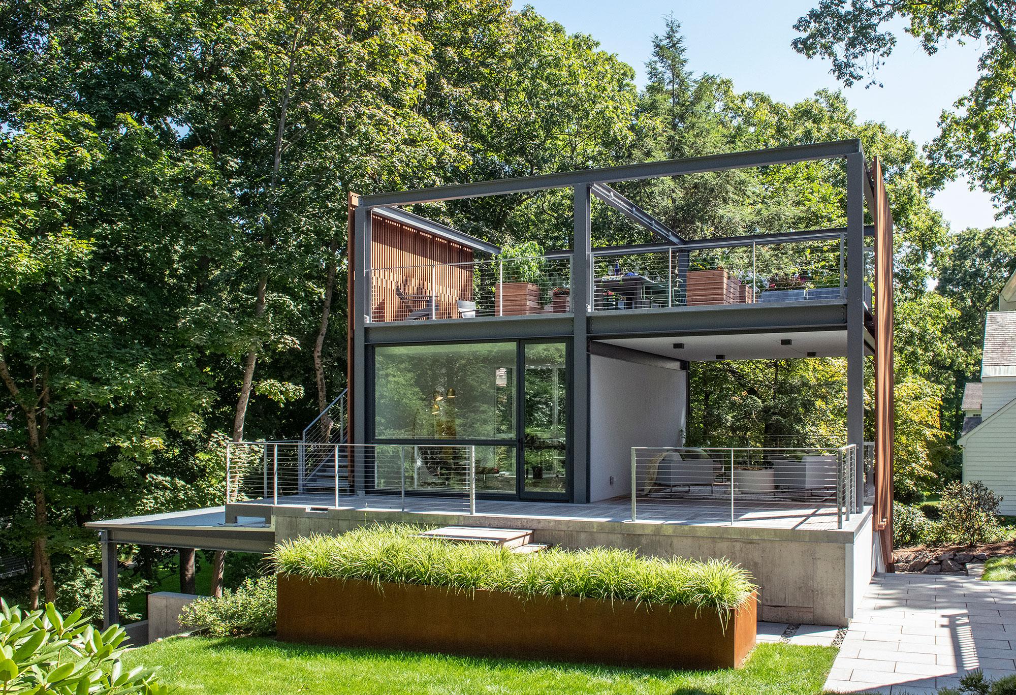 3-story studio garage structure with rooftop garden open-air veranda home office corten steel planter