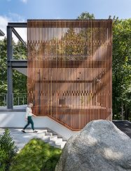 3-story outdoor structure with wood screen