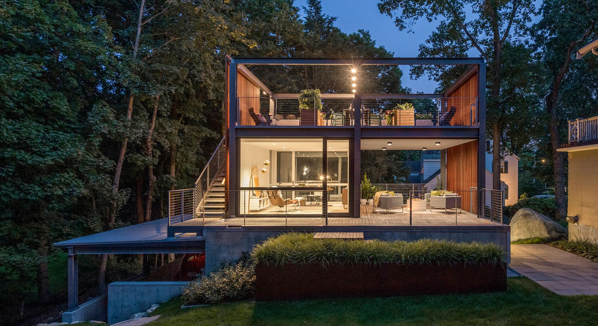 3-story backyard home office studio rooftop open-air veranda glowing at dusk