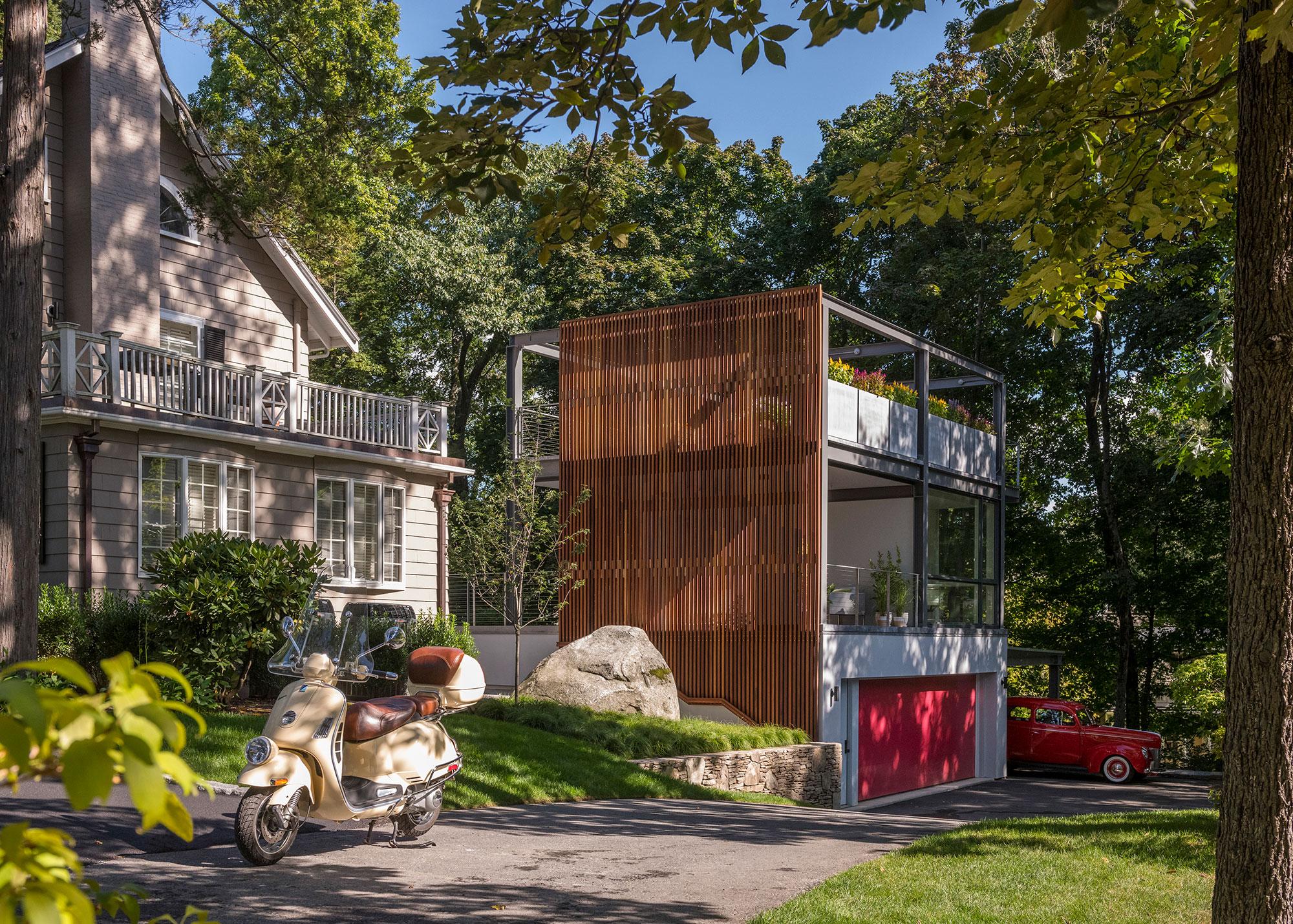 3-story garden folley studio garage accessory building with vintage vespa