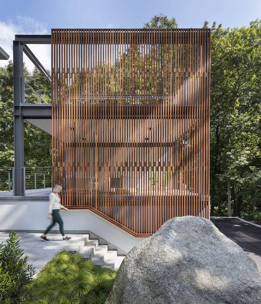 exterior 3-story garage studio steel structure with wood screen