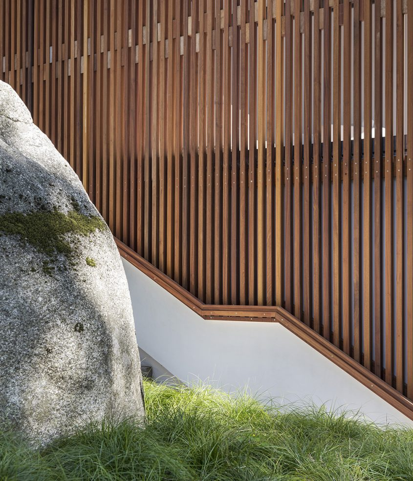 detail of privacy wood screen with wood handrail
