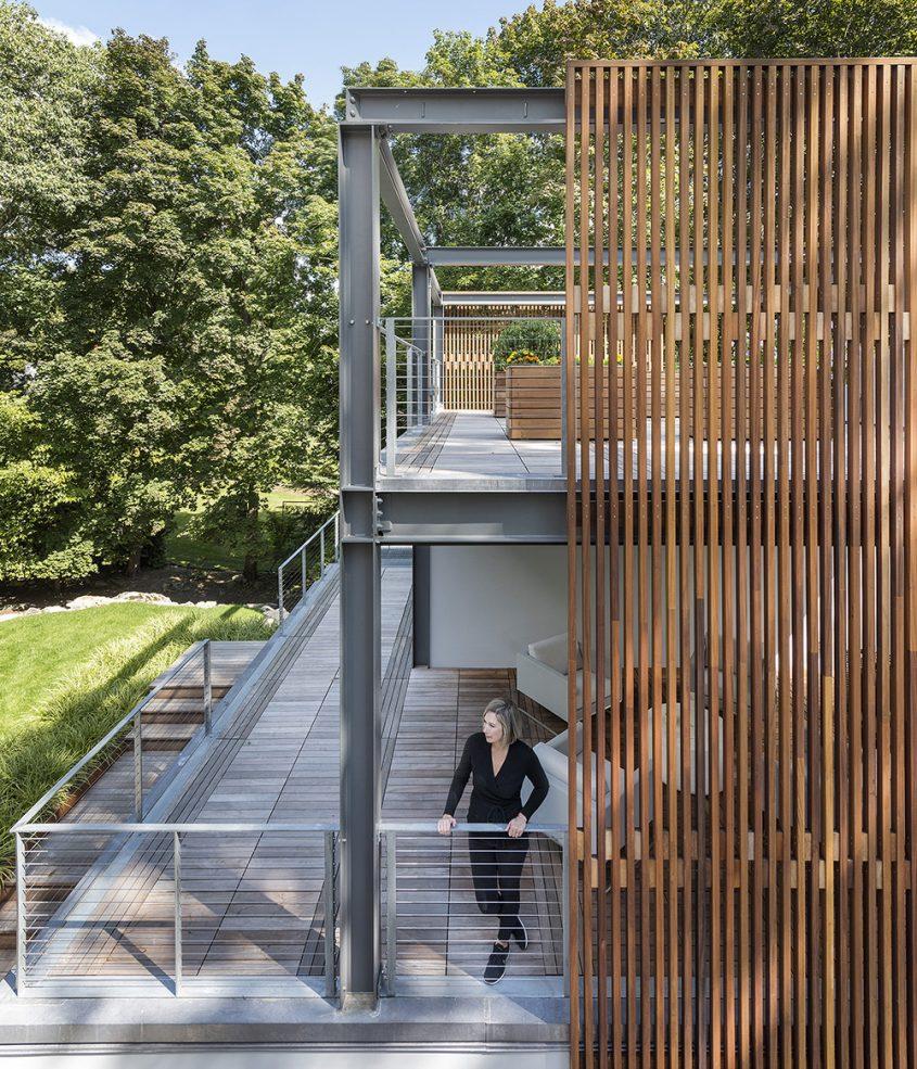 exposed steel structure rooftop garden and open-air veranda with wood screen