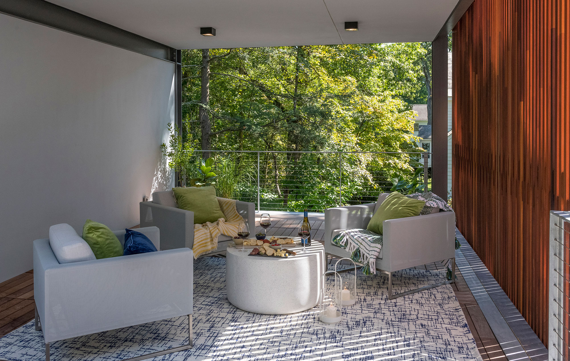 furnished open-air veranda with privacy wood screen