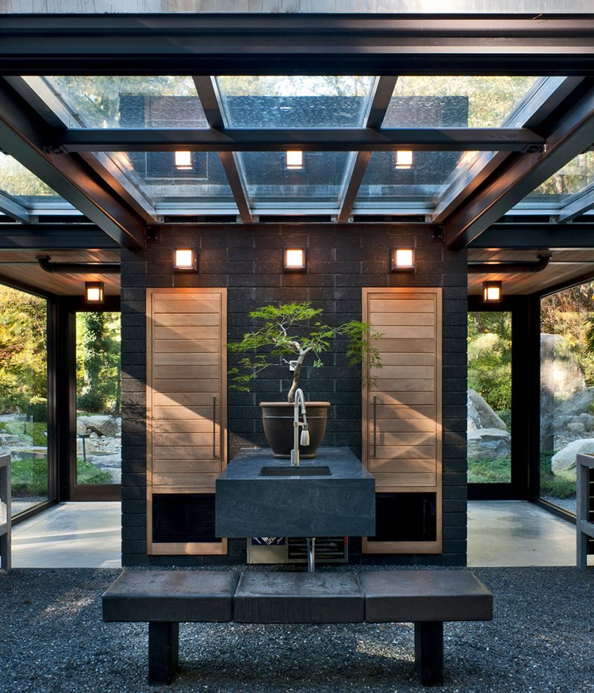 bonsai greenhouse with glass roof and garden sink