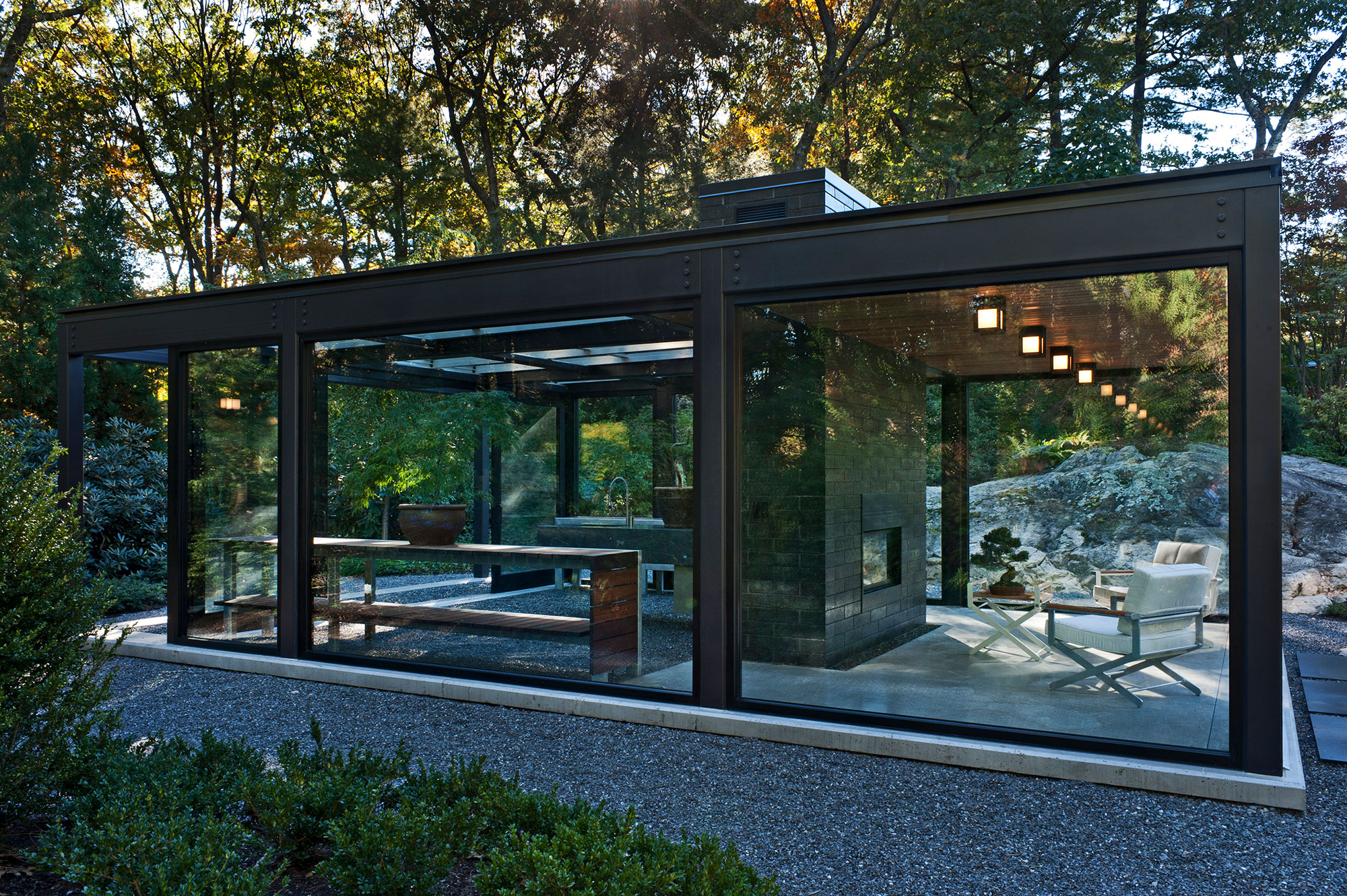 steel and glass green house with large fireplace