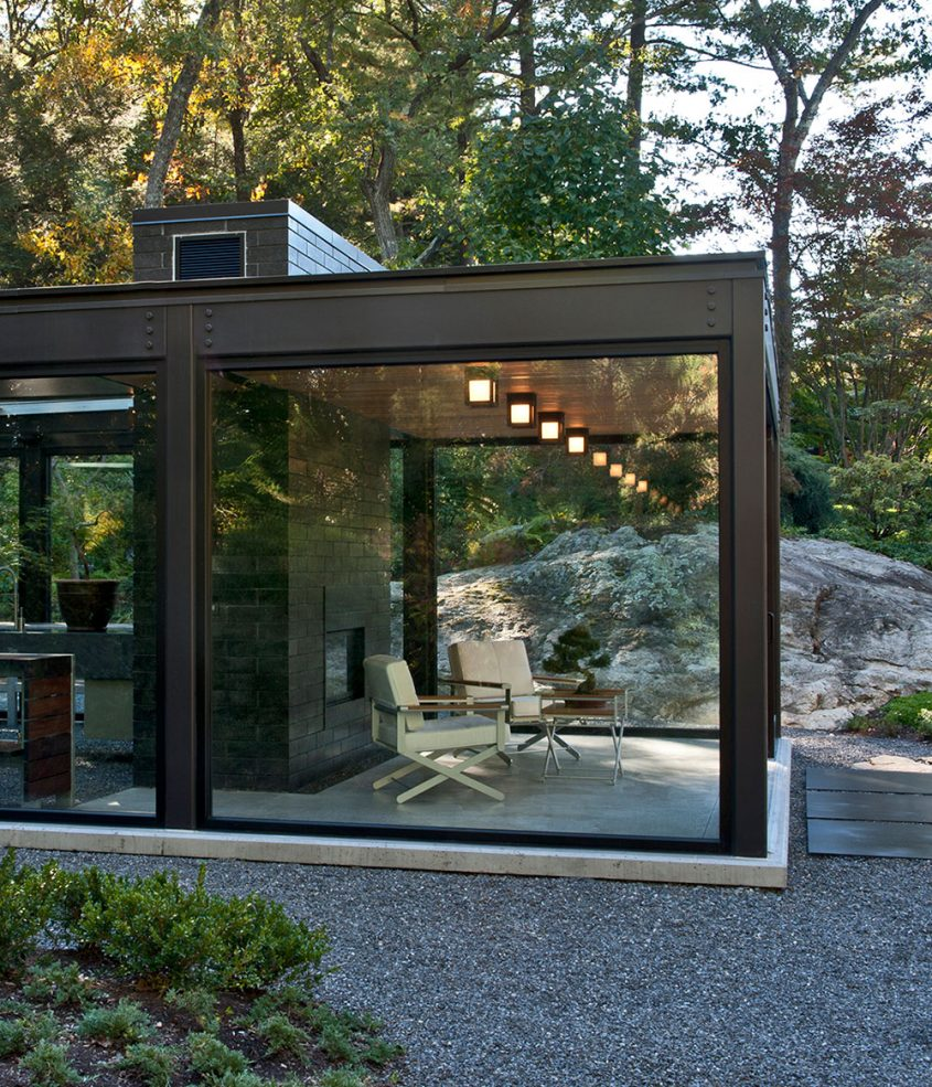 meditation studio with fireplace made of steel and glass