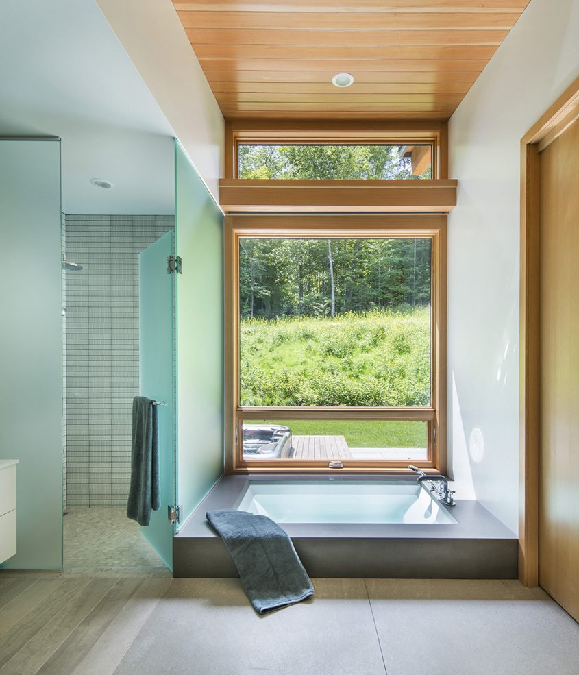 master bath with sunken soaking bath and window view