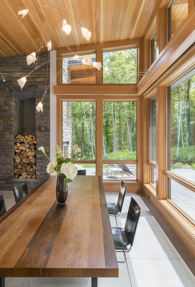 open layout with dining room view of surrounding woods