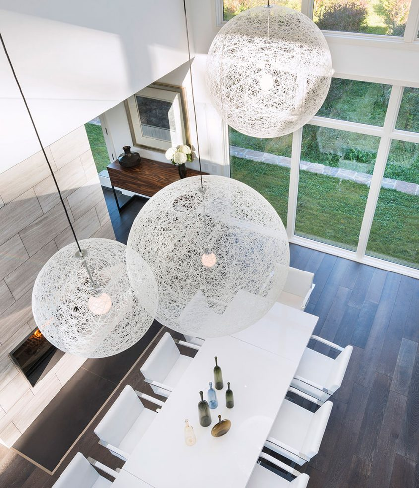 view of dining room from interior balcony and moooi pendant detail