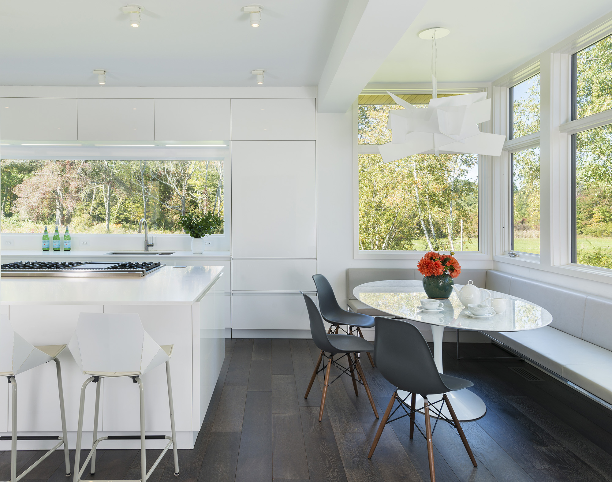 modern white eat-in kitchen with corner window breakfast nook