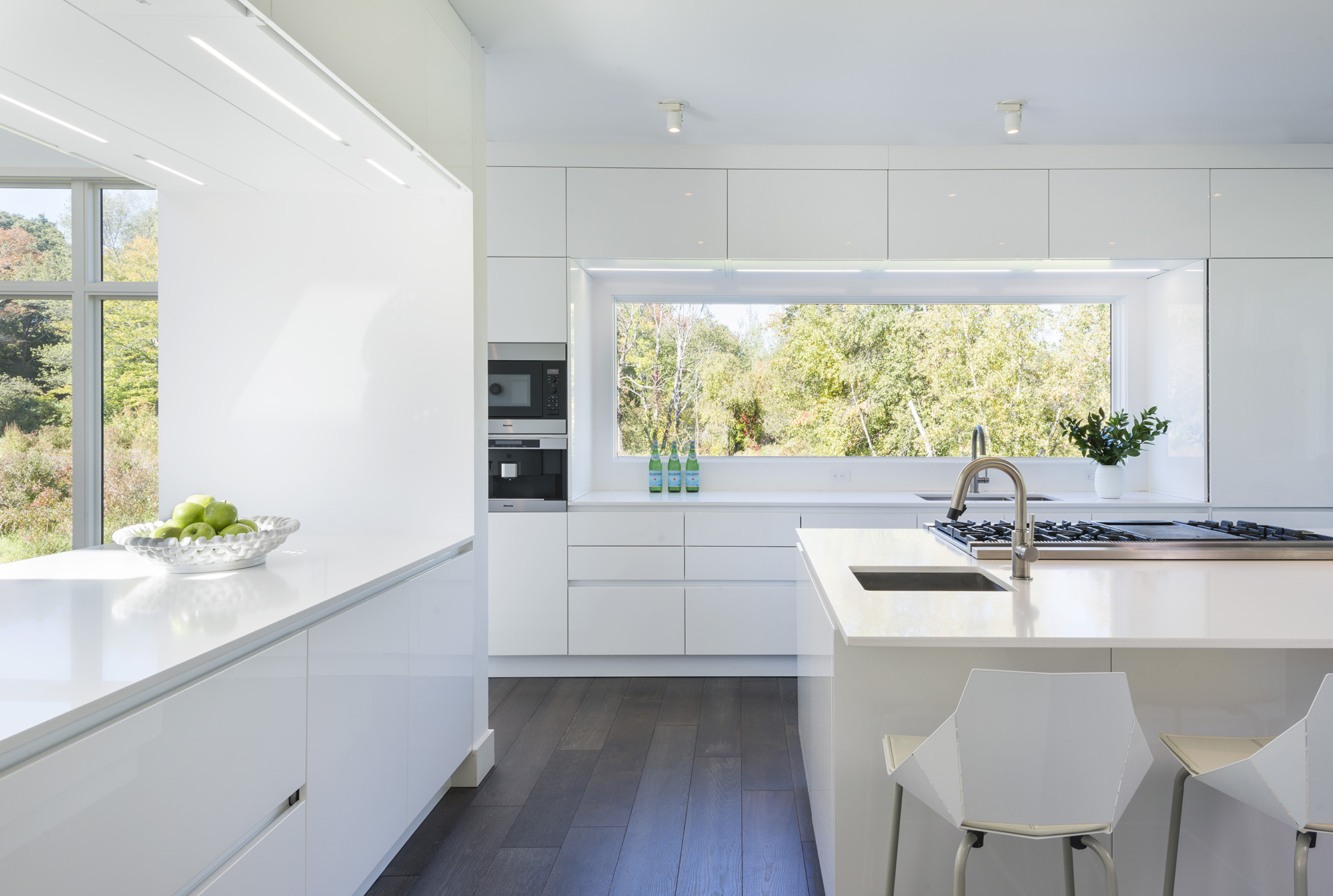 modern white kitchen with window backsplash