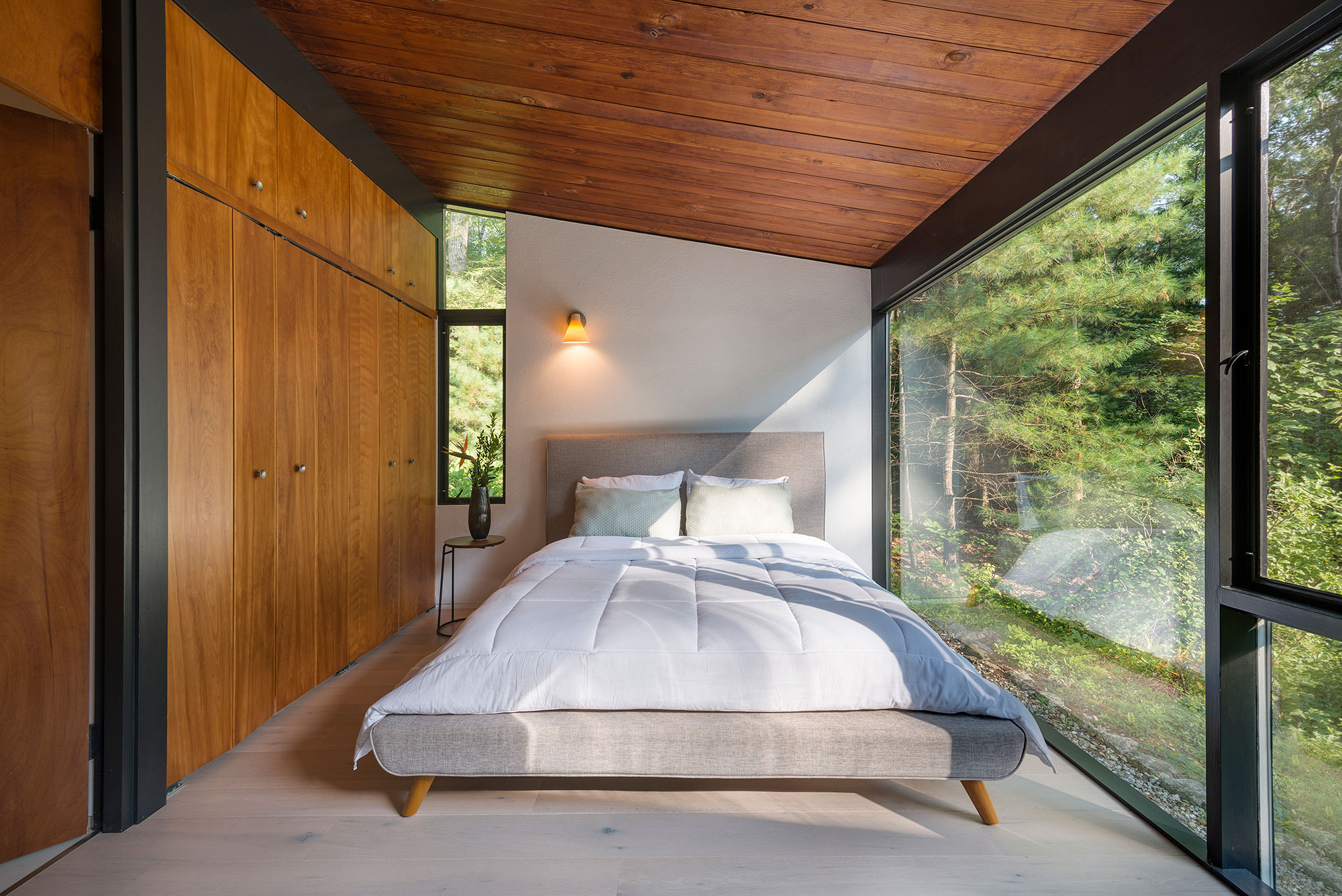 mid-century modern master bedroom large windows