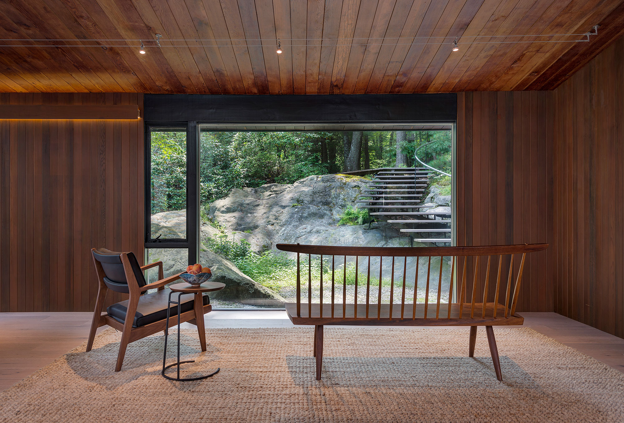 mid-century modern living room with rock ledge view