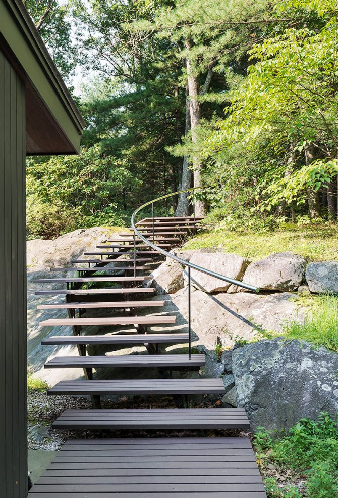 mid-century modern stair through natural rock ledge