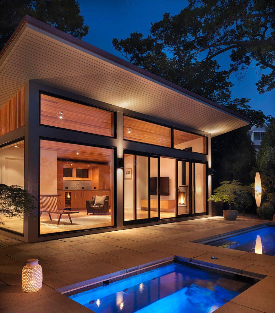 hot tub and pool house cabana glowing at dusk