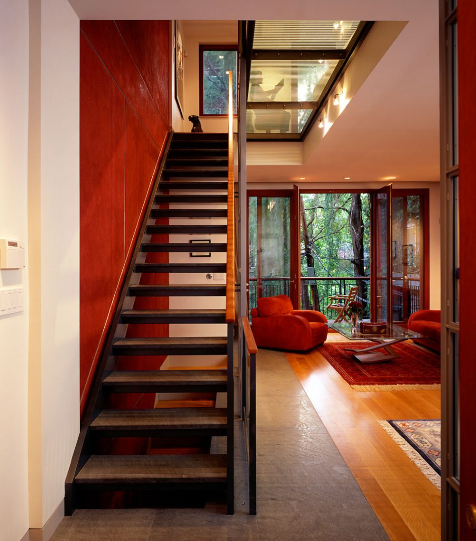 staircase and glass floor in rowhouse living room