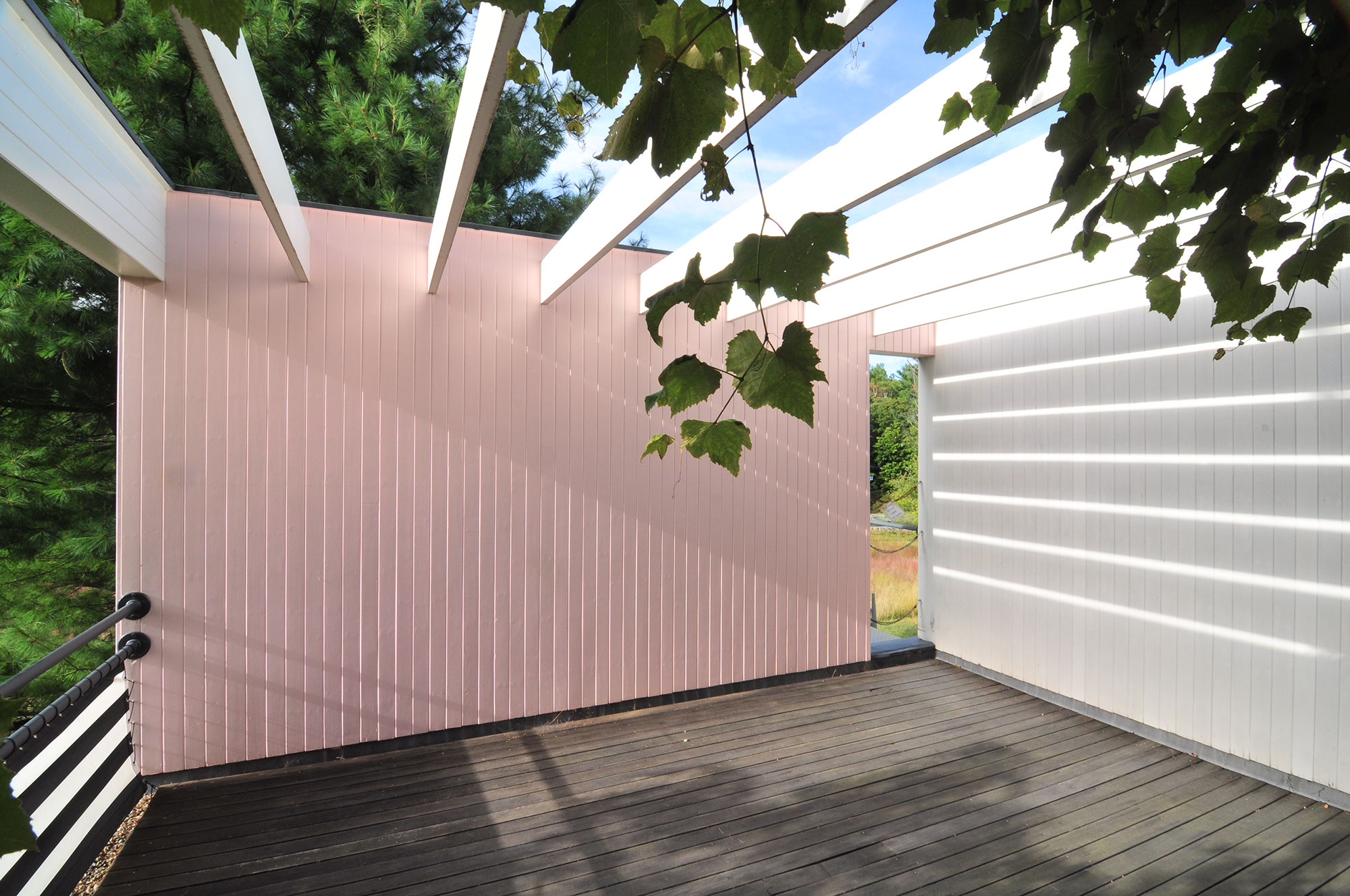 roof deck of home with exposed beam trellis