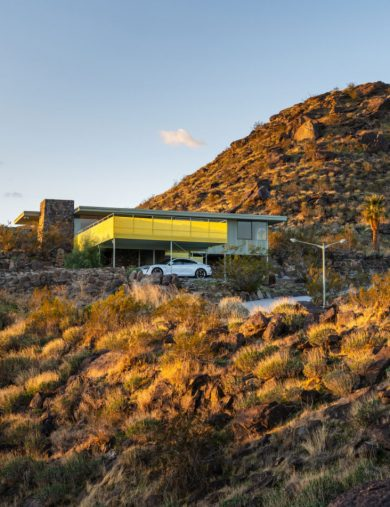 mid-century modern in the hilly desert landscape