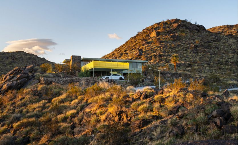 mid-century modern in the hilly desert landscape