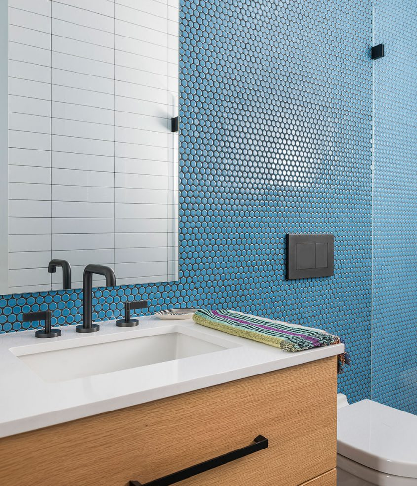 bathroom with baby blue penny round and subway tile