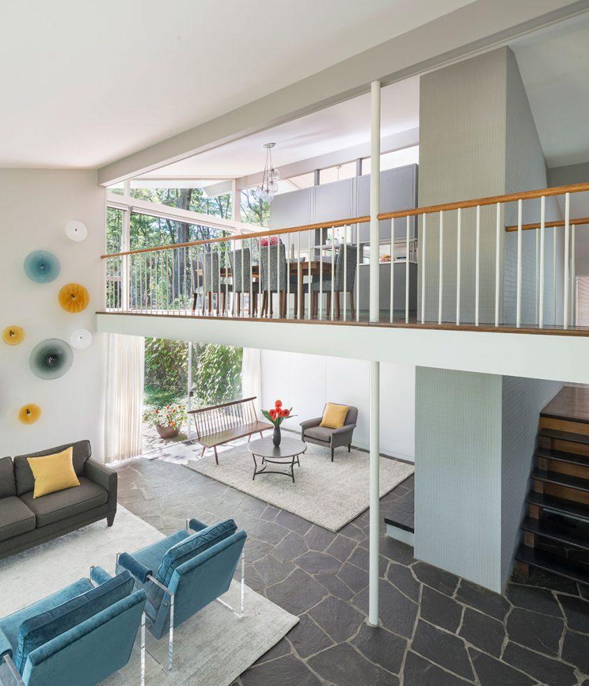 mid-century modern interior balcony overlooking living room