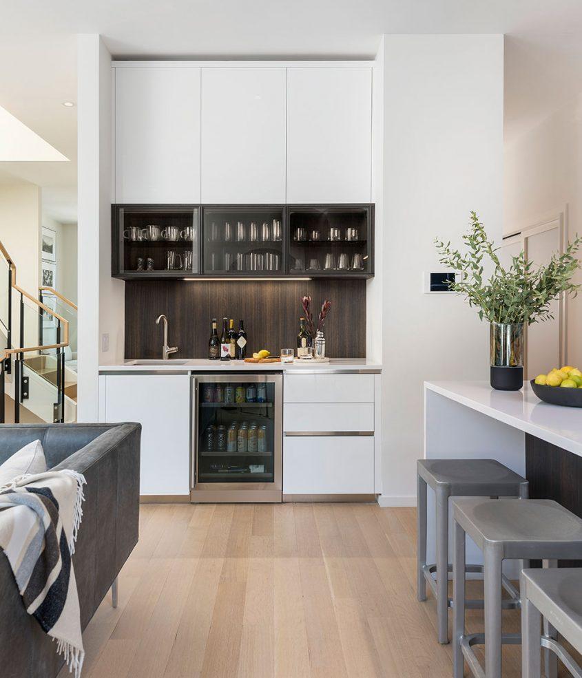 modern wet bar adjacent to kitchen