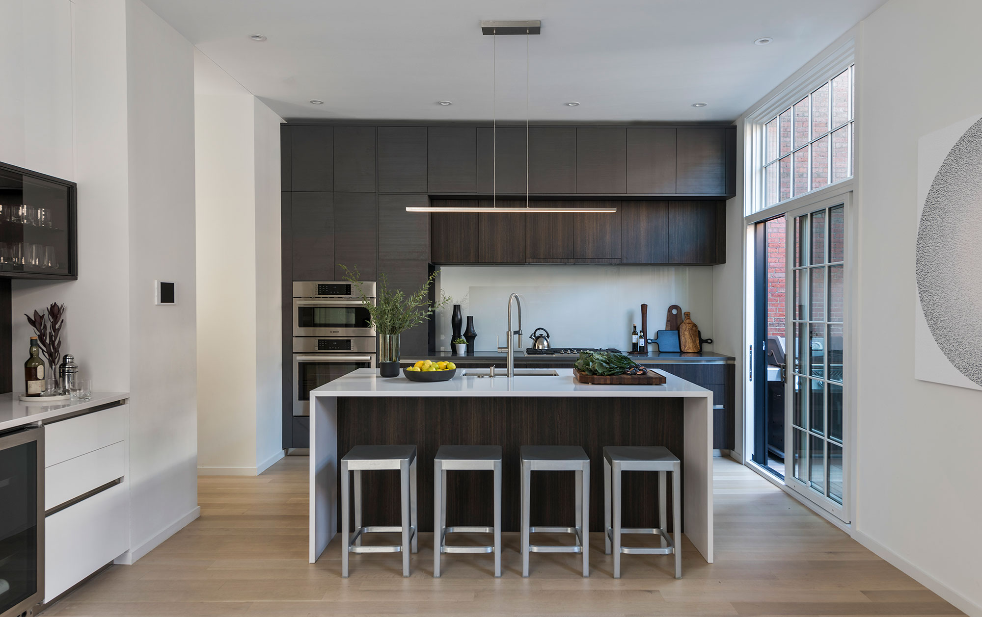 kitchen with sink island and outdoor balcony