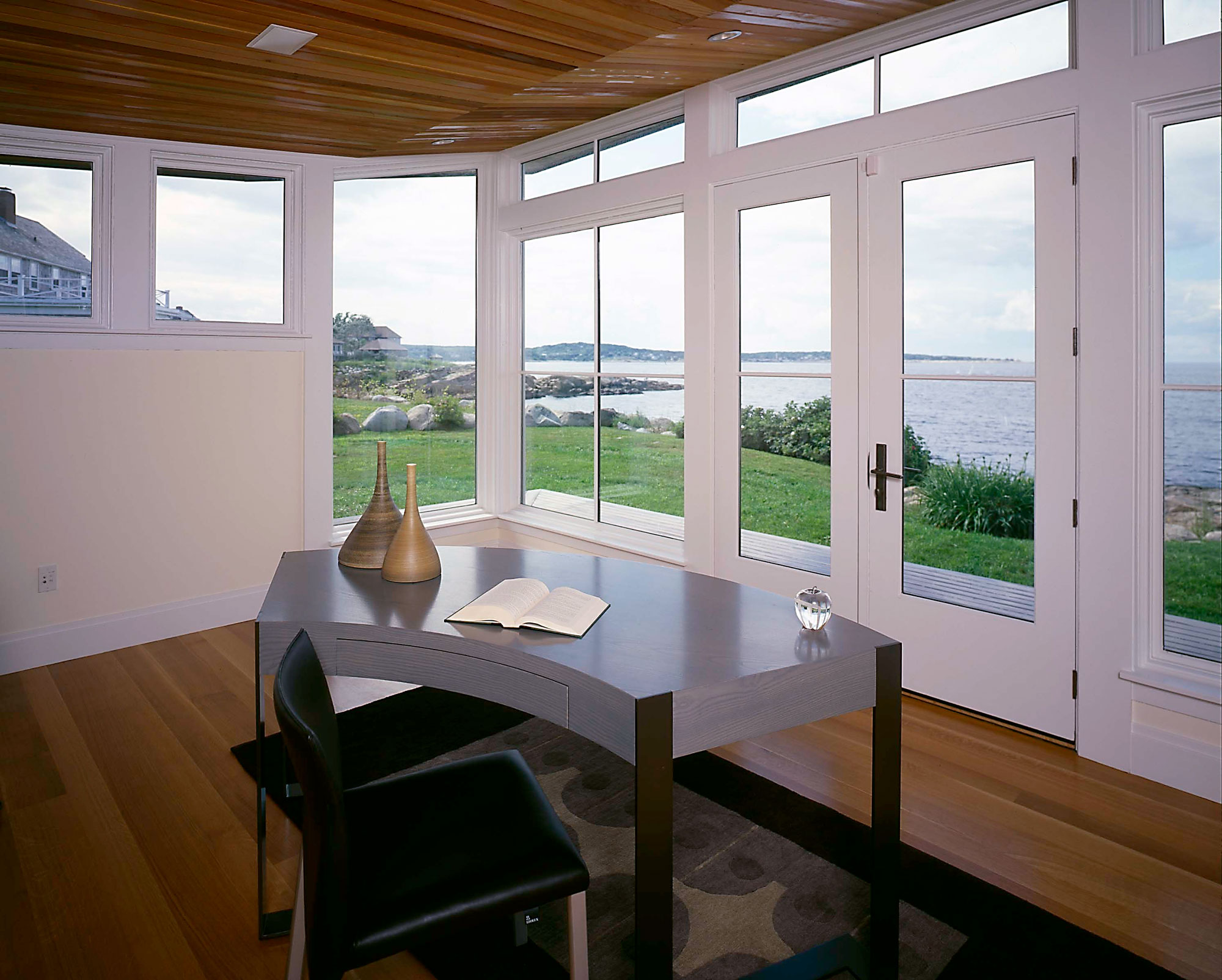 interior of home office with ocean views and wood ceiling