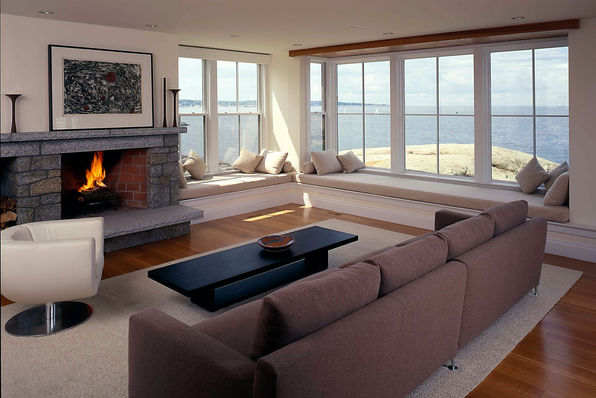 living room interior with fireplace and ocean views