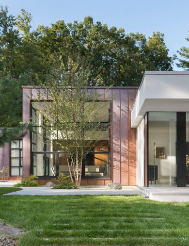 copper clad home with stucco and glass addition