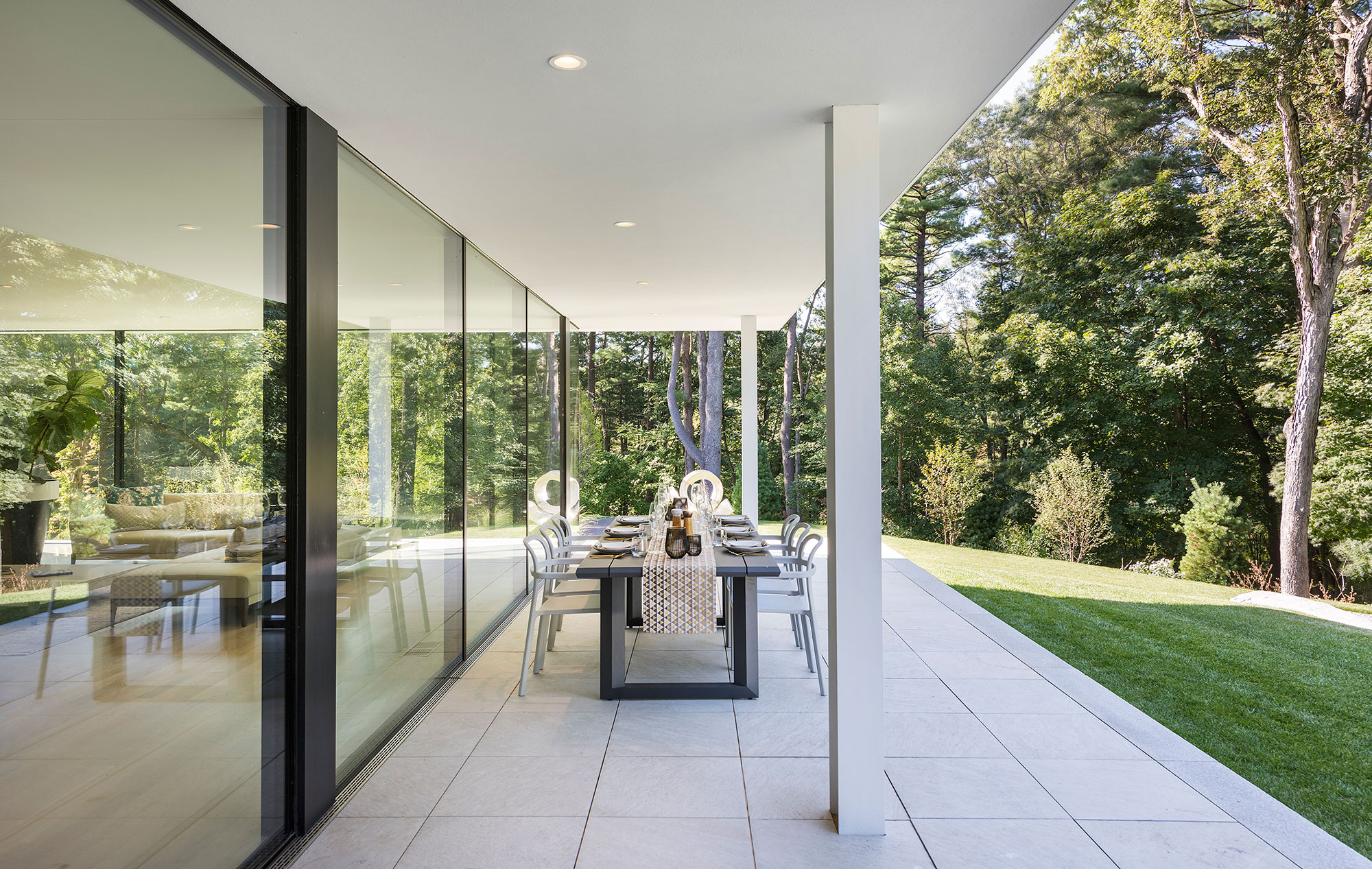 outdoor dining terrace with cantilevered roof