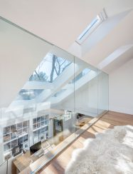 interior glass wall balcony with skylights