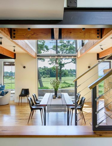 interior of dining room with exposed timber beams