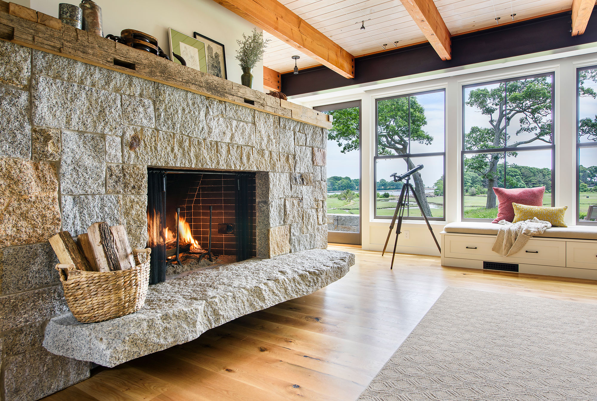 large natural stone fireplace and reclaimed railroad tie mantle