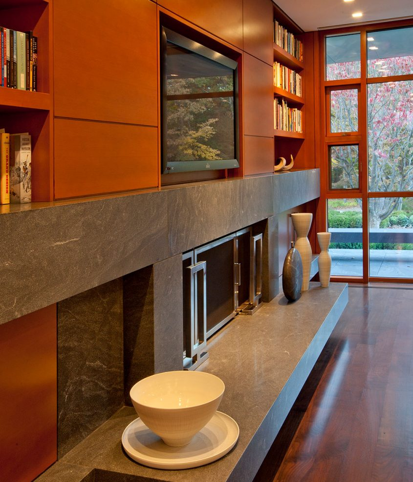 built-in cabinets with recessed tv and fireplace below