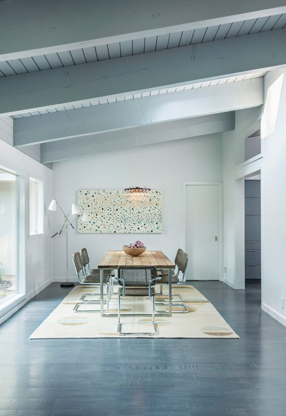 mid-century modern dining room with exposed beams