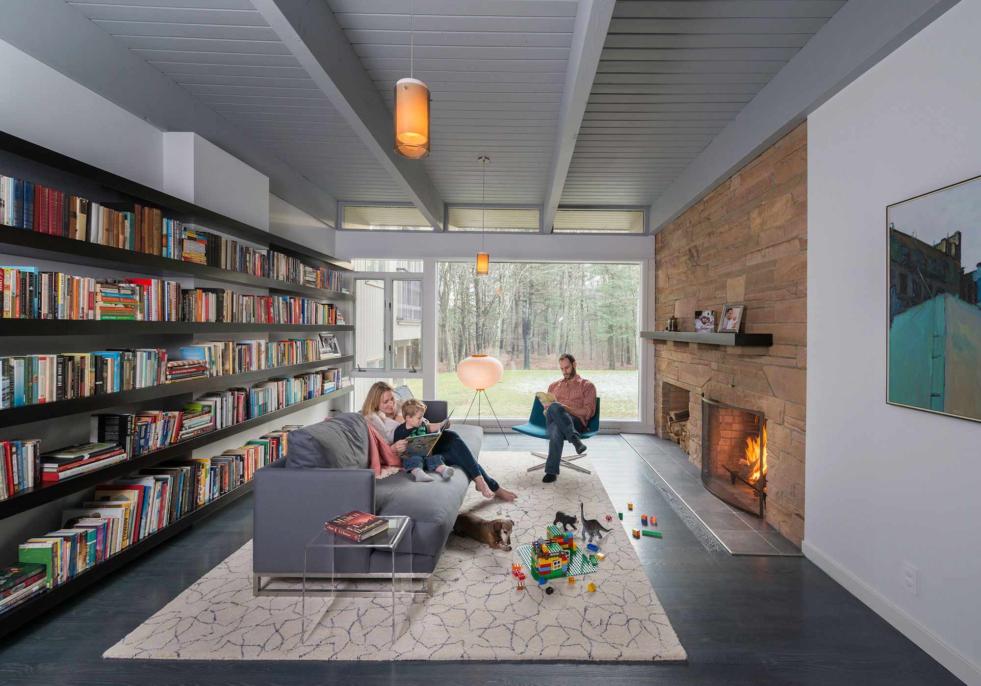 mid-century modern family room with fireplace