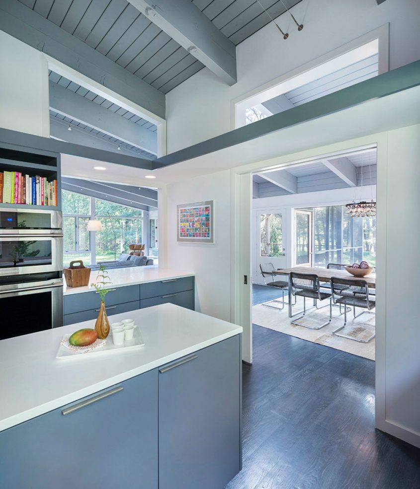 mid-century modern kitchen with pocket doors to dining room