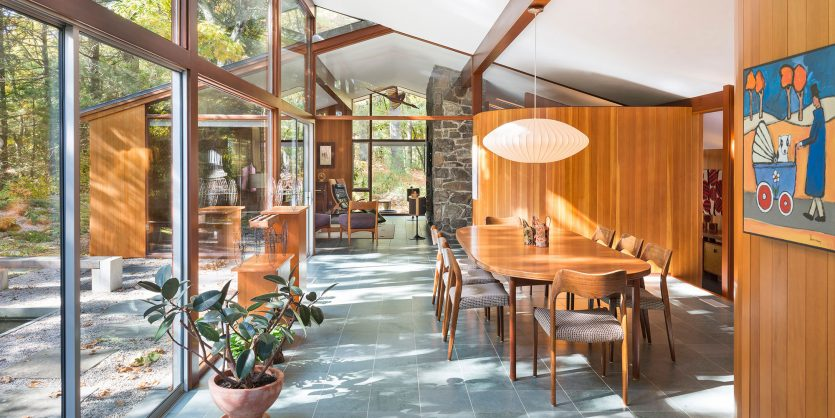 mid-century modern dining room floor to ceiling windows