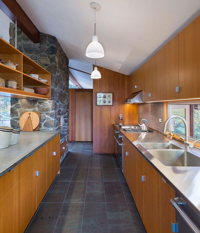 mid-century modern galley kitchen with wooden cabinets
