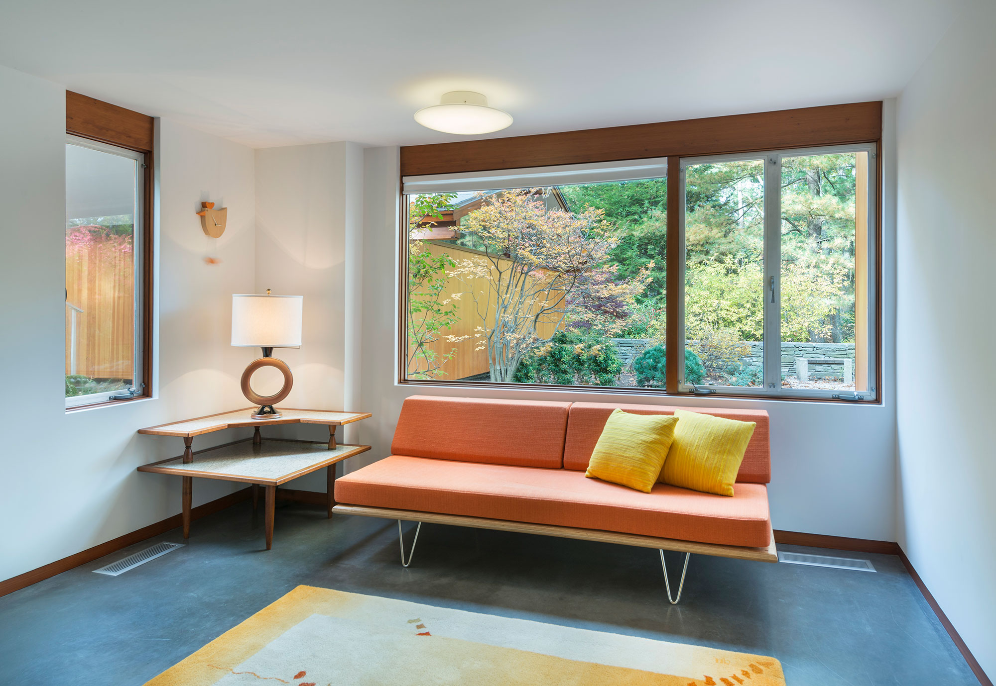 mid-century modern living room interior with sofa