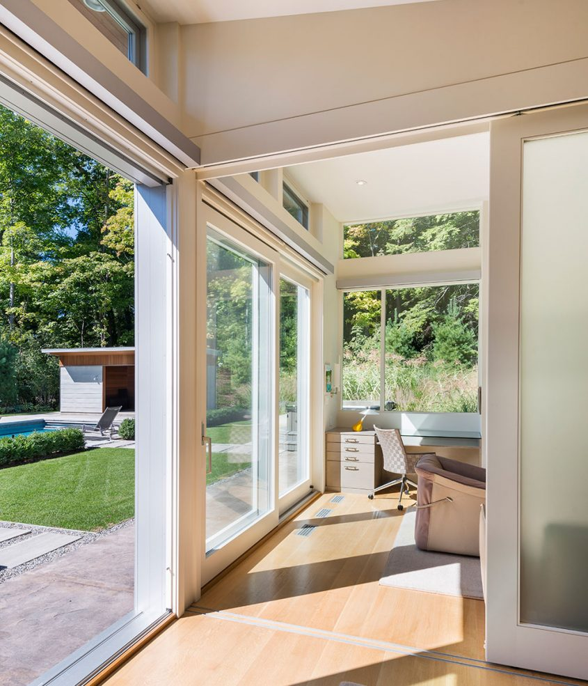 sliding glass doors lead out to swimming pool terrace